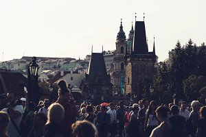 People walking across Charles Bridge