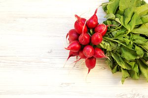 Fresh red radish on a white wooden