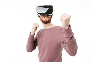 Young smiling man wearing virtual