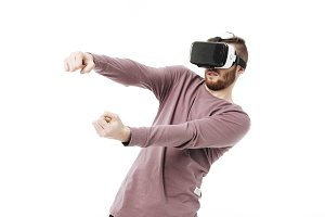 Young man in virtual reality glasses