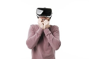 Young amazed man using virtual