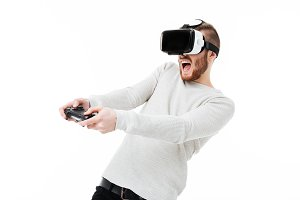 Young emotional man using virtual