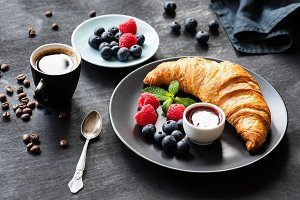 Croissant with berries and coffee