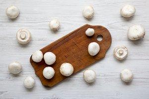 Champignon mushrooms on wooden board