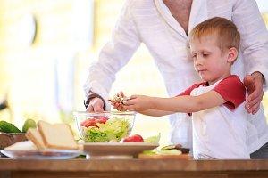 Photo of man and son preparing salad
