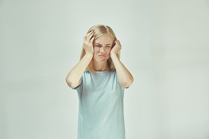 Woman having headache. Isolated over