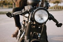 Young man riding motorcycle by  in Transportation