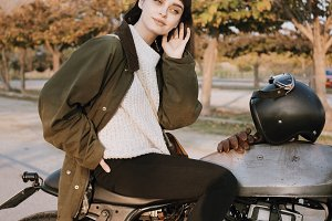 woman sits on her motorcycle