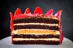 Chocolate cake with sliced red pears