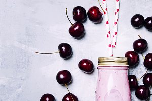 Cherry yogurt in a glass bottle, top