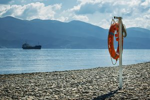 Lifebuoy on the beach, summer landsc