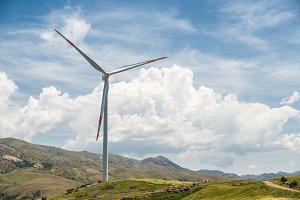 Big wind turine against blue sky