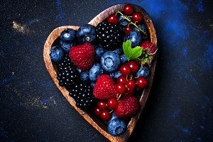 Selection of summer berries in heart