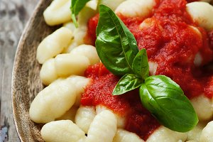 Italian gnocchi with tomato and basi