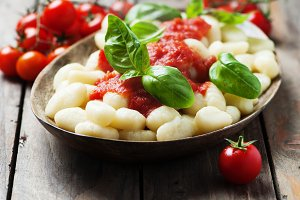 Italian gnocchi with tomato and basi