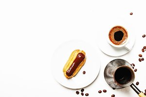 Morning coffee with eclair cake, whi