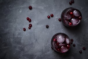 Alcohol cocktail with cranberries an