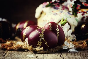 Easter red and burgundy eggs with go