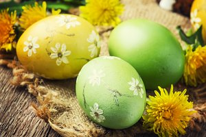 Easter yellow and green eggs with sp
