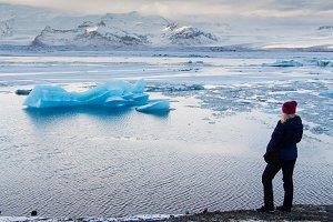 Young woman Jokulsarlon glacier lake