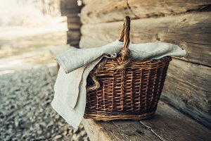 Basket with towel on the wooden