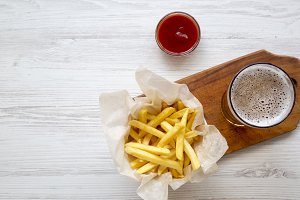 French fries, ketchup and cold beer