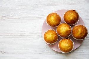 Tasty muffins on pink round plate