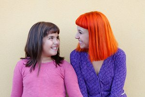 Red haired mom and her daughter