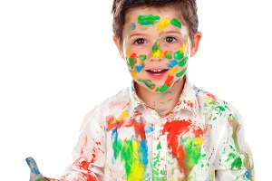 Funny boy dirty with paint