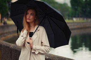 beautiful blonde girl with umbrella