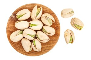 Pistachios in wooden bowl isolated