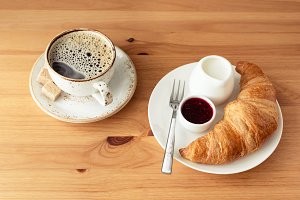 Breakfast with croissant and coffee