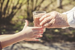 Grandmother giving a glass of  water