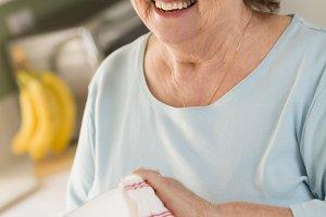 Senior Adult Woman Drying Bowl At Si