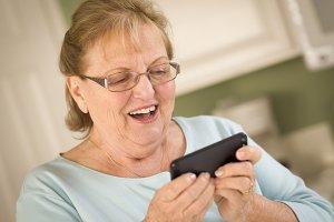 Senior Adult Woman Texting on Smart