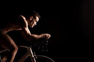 Man on bicycle preparing for triathl