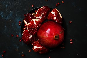 Red Pomegranate On The Plate, Black