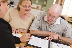 Senior Adult Couple Going Over Paper