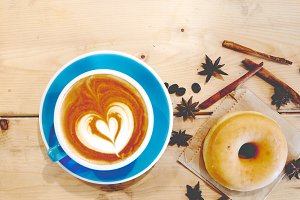 Hot coffee heart in blue cup and don