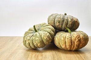 Pumpkins against a rustic