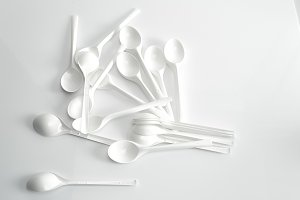 White spoon on white background