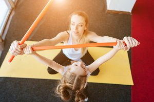 Little girl and mom doing exercises