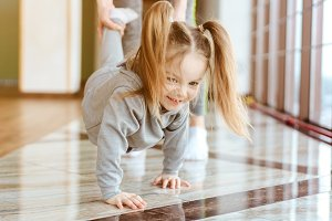 Little girl crawls on her hands