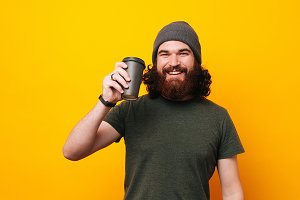 Cheerful young bearded hipster man