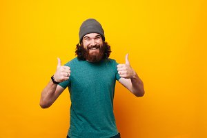 Happy smiling bearded hipster man