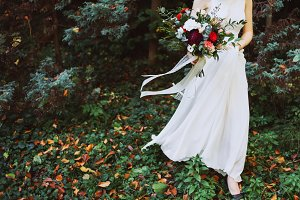 Bride holds a bouquet of flowers