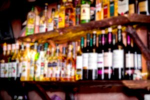 Bartender with blur Bar shelf backgr