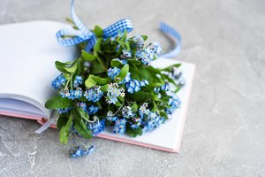 Forget me not flowers and notebook