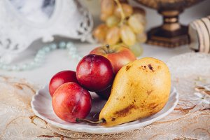 Seasonal fruits pears and plums in a