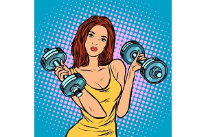 beautiful woman with dumbbells in
